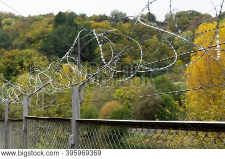 Barbed Wire - Restricted Area. Barbed Wire On The Fence. Closed Area And Barbed Wire.