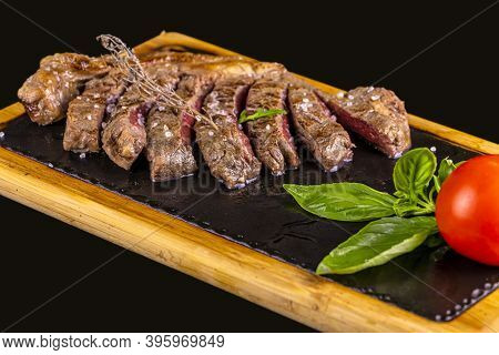 Food - Grilled Beef Steak On The Iron Plate With Salt Crystals, Basil And Tomato