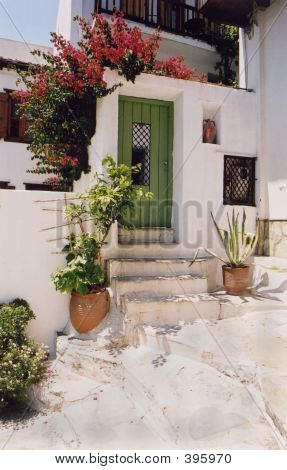 Greek Doorway With Stunning Bougainvillea