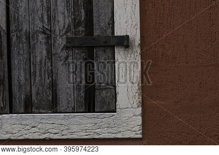 Detail Of Old Wooden Window. Vintage Object With Particular On The Object Iron Closing Hinge.