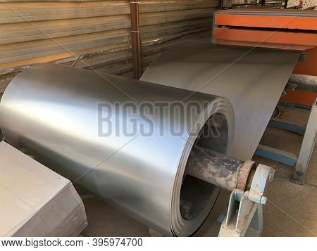 Rolled Halvanized Metal At Construction Site Workshop. Tinsmith Metal Material