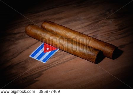 Luxury Cuban Cigars And Match Bow On The Wooden Desk