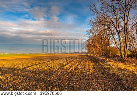 Autumn Morning Landscape Over The City Of Louny. Autumn Plowed Field At Amazing Sunrise. Czech Repub