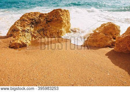 Waves Crash On Rocks In The Atlantic Ocean At Benagil Beach In Portugal