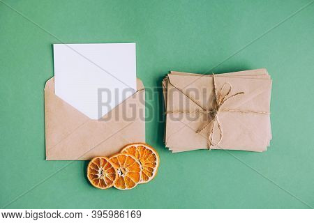 Craft Envelopes With Letters And Postcards. An Envelope With A White Blank Sheet Of Paper To Write A