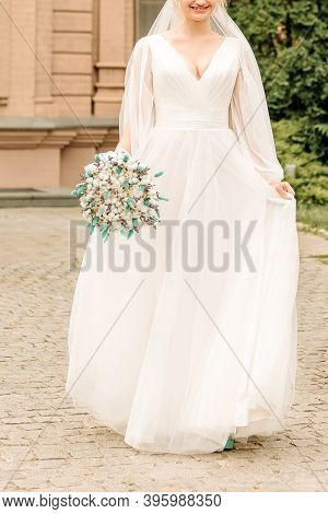 Beautiful Slender Bride With A Gentle Hairstyle And A Beautiful Airy Dress