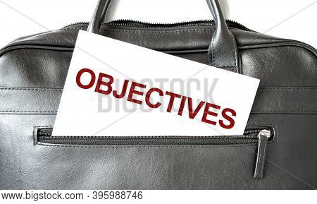Text Objectives Writing On White Paper Shit In The Black Business Bag. Business Concept