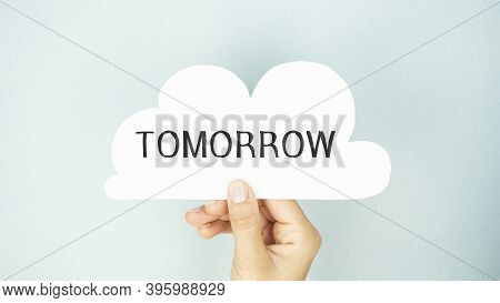 Tomorrow Text On Paper In The Form Of A Cloud In Hand.