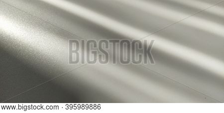 Gray Striped Background With Oblique Light Effect. Play Of Light And Shadow. Light Rays. Gray And Si