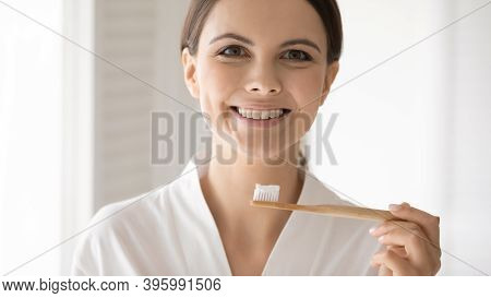 Excited Lady With Healthy Teeth Holding Bamboo Brush With Paste