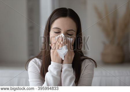 Weak Sneezing Young Woman Blowing Nose In Paper Napkin