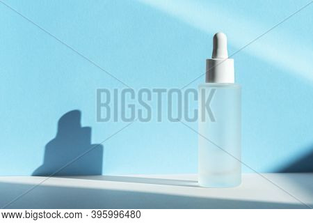 Hyaluronic Acid Oil Tincture. Transparent Liquid Emulsion In Glass Bottle With Dropper. Serum With C