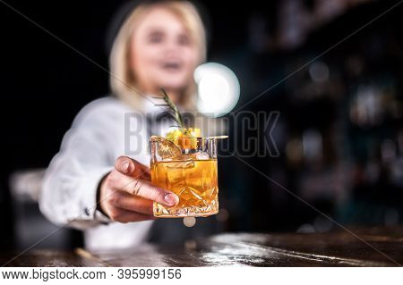 Girl Bartender Mixes A Cocktail At The Saloon