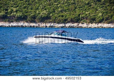 Speed Boat On Blue Water