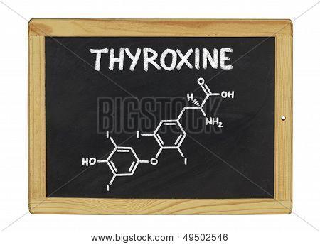 chemical formula of thyroxine on a blackboard