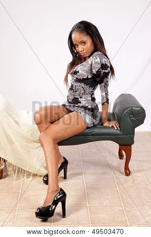 Pretty black woman sitting and smiling at the camera