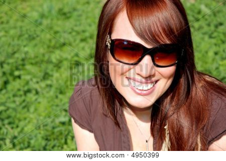 Happy Young Woman In The Summer Sun