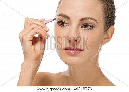 Beautiful Young Woman And Eyebrow Tweezers