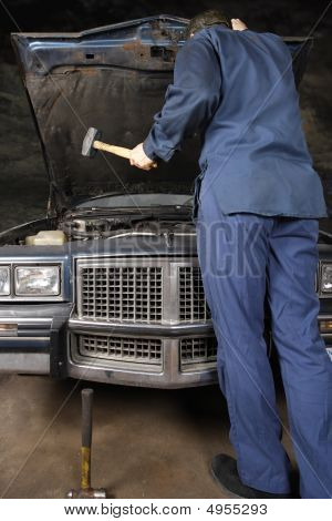 Engine Repair With Hammer