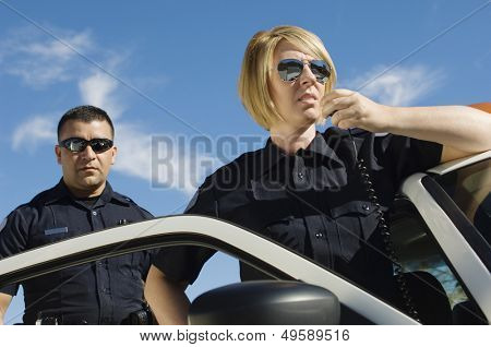Police Officers Using Two-Way Radio