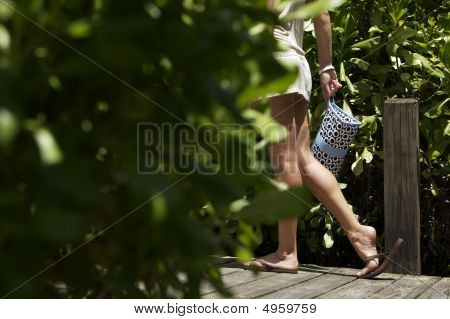 Woman Carrying Bag Outside