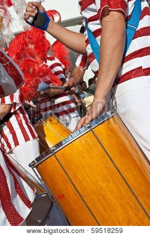Sesimbra, Portugal - Feb. 2013 - Drummer in the Bateria (musical section) playing for the Samba dancers in the Rio de Janeiro style Carnival. One of the most important Carnivals in Portugal.