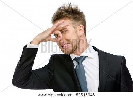 Half-length portrait of manager covering his nose, isolated on white. Concept of stink and disgust