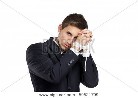 Half-length portrait of businessman with bound hands, isolated on white. Concept of slavery and hard work