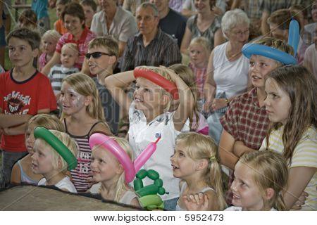 Spectators during a clown show