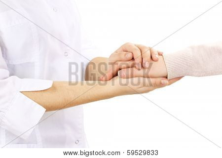 Medical doctor holding hand of patient, isolated on white