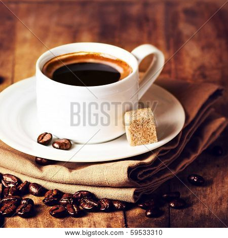 Cup Of Coffee With Coffee Beans On Wooden  Brown Background In Rustic Style, Closeup.