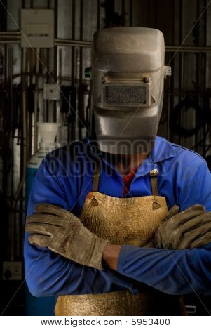 African Welder With Mask