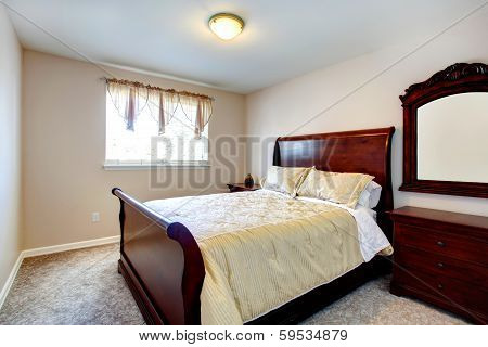 Bright Bedroom With Cherry Wood Furniture
