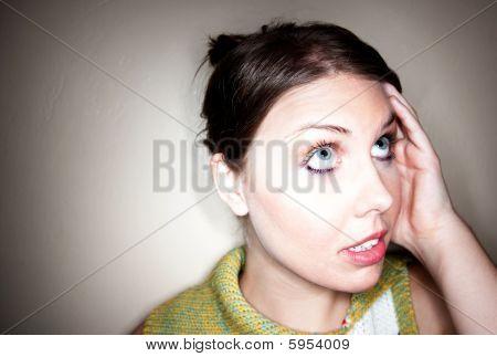 Cute Confused Girl In Spotlight