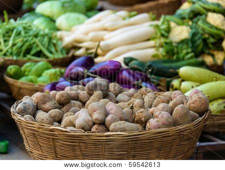 Potatoes and other vegetables for sale on a market