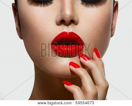 Fashion Model Girl portrait. Red Sexy Lips and Nails closeup. Open Mouth. Manicure and Makeup. Make up concept.  Beauty woman face