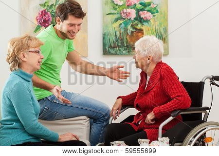 Young Man Tallking With Two Older Women