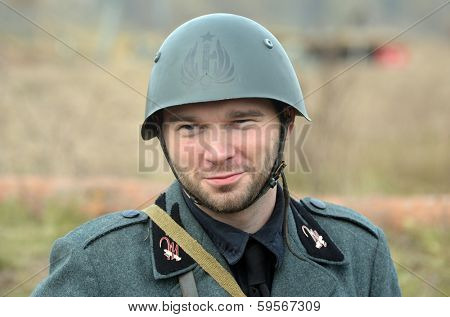 KIEV, UKRAINE -NOV 1 An unidentified member of Red Star history club wears historical Italian uniform during historical reenactment of WWII, Battle for Kiev 1943 on November 1, 2013 in Kiev, Ukraine