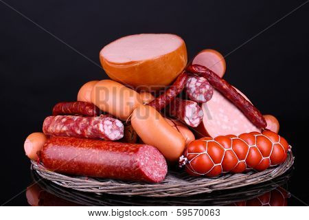 Lot of different sausages on black background poster