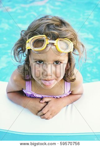 a young girl in aa blow up pool