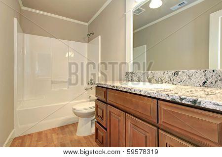 Empty Bathroom With Wooden Storage
