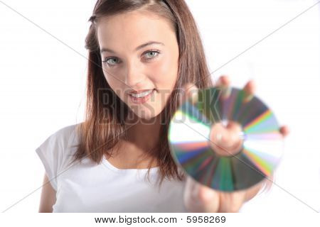 Attractive woman holding CD-Rom
