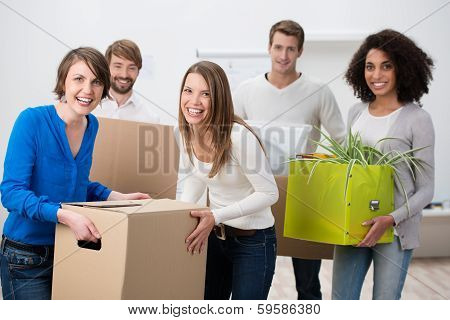 Laughing Group Of Young Friends Moving House