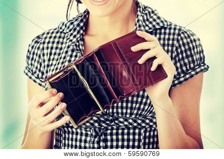 Young woman shows her empty wallet. Bankruptcy  poster