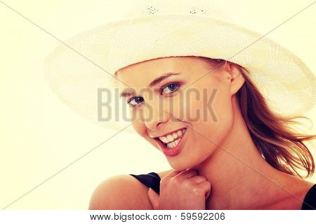 Beautiful young caucasian woman in swimsuit and hat