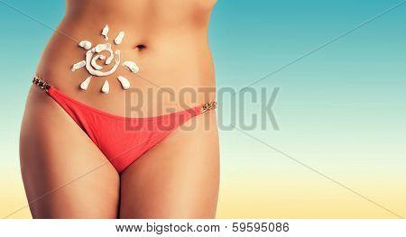 Beautiful female body on the beach