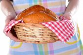 Fresh baked pasties with berries in wicker basket close-up poster