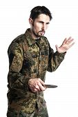 Male self defense instructor with camouflage do a self defense exercise with knife isolated on white background poster