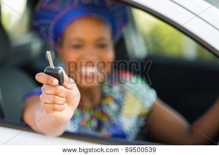 african zulu woman showing car key inside new vehicle
