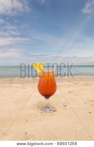 Refreshing orange cocktail on beach